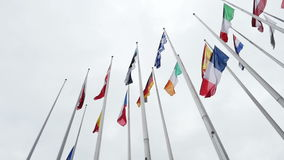UE and French flag flies half-mast at the European Parliament. Slow motion of the French and European Union Flag flies at half-mast in front of the European stock video footage