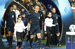UEFA Champions League: FC Dynamo Kyiv v Benfica. KYIV, UKRAINE - OCTOBER 19, 2016: Referee David Fernandez Borbalan and his assistans go to the pitch before UEFA stock photography