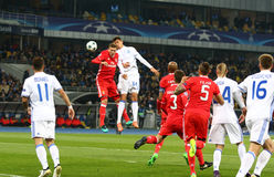 UEFA Champions League: FC Dynamo Kyiv v Benfica. KYIV, UKRAINE - OCTOBER 19, 2016: FC Dynamo Kyiv (in White) and SL Benfica players fight for a ball during their royalty free stock photo