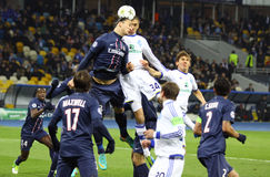 UEFA Champions League game Dynamo Kyiv vs PSG. KYIV, UKRAINE - NOVEMBER 21, 2012: Zlatan Ibrahimovic of FC Paris Saint-Germain (L) fights for a ball with Yevhen Royalty Free Stock Images
