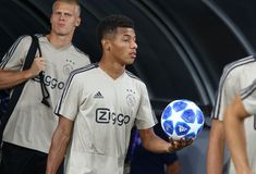 UEFA Champions League play-off: FC Dynamo Kyiv v Ajax. KYIV, UKRAINE - AUGUST 28, 2018: David Neres of AFC Ajax goes to the pitch of NSC Olimpiyskyi stadium at royalty free stock photos