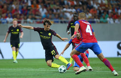 UEFA CHAMPIONS LEAGUE QUALIFICATION – STEAUA BUCHAREST vs. MANCHESTER CITY. Manchester City's David SIlva ( C ) in action during the UEFA Champions Stock Photos