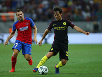 UEFA CHAMPIONS LEAGUE QUALIFICATION – STEAUA BUCHAREST vs. MANCHESTER CITY. Manchester City's David SIlva ( R ) vies for the ball with Steaua Bucharest's Stock Image