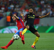 UEFA CHAMPIONS LEAGUE QUALIFICATION – STEAUA BUCHAREST vs. MANCHESTER CITY. Manchester City's Gael Clichy ( R ) vies for the ball with Steaua Bucharest's Stock Images