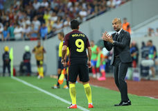UEFA CHAMPIONS LEAGUE QUALIFICATION – STEAUA BUCHAREST vs. MANCHESTER CITY. Manchester City's head coach Pep Guardiola ( R ) in action during the UEFA Royalty Free Stock Photo