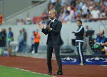 UEFA CHAMPIONS LEAGUE QUALIFICATION – STEAUA BUCHAREST vs. MANCHESTER CITY. Manchester City's head coach Pep Guardiola ( R ) in action during the UEFA Royalty Free Stock Images