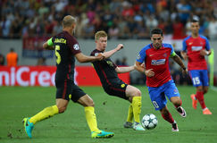 UEFA CHAMPIONS LEAGUE QUALIFICATION – STEAUA BUCHAREST vs. MANCHESTER CITY. Manchester City's Kevin De Bruyne ( CL ) vies for the ball with Steaua Stock Image