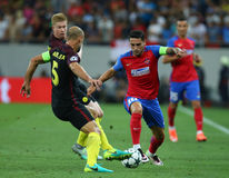 UEFA CHAMPIONS LEAGUE QUALIFICATION – STEAUA BUCHAREST vs. MANCHESTER CITY. Manchester City's Kevin De Bruyne ( CL ) vies for the ball with Steaua Royalty Free Stock Image