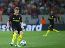 UEFA CHAMPIONS LEAGUE QUALIFICATION – STEAUA BUCHAREST vs. MANCHESTER CITY. Manchester City's Kevin De Bruyne ( L ) in action during the UEFA Champions Royalty Free Stock Photos