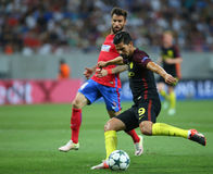 UEFA CHAMPIONS LEAGUE QUALIFICATION – STEAUA BUCHAREST vs. MANCHESTER CITY. Manchester City's Manuel Agudo Duran ''NOLITO'' ( R ) in action during the Royalty Free Stock Images