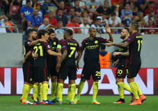 UEFA CHAMPIONS LEAGUE QUALIFICATION – STEAUA BUCHAREST vs. MANCHESTER CITY. Manchester City's players celebrates after scoring during the UEFA Champions Stock Photo