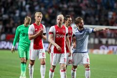 UEFA Champions League third qualifying round between Ajax vs PAOK. Amsterdam, Netherlands- July 26, 2016: The players Ajax salute the fans after the end match stock photography