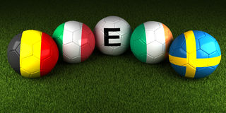 UEFA EURO 2016 balls with the flag of Group E Belgium Italy Irel. And Sweden on the green grass of stadium Stock Photo