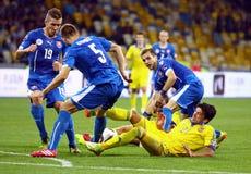UEFA EURO 2016 Qualifying game Ukraine vs Slovakia. KYIV, UKRAINE - SEPTEMBER 8, 2014: Edmar of Ukraine (in Yellow) fights for a ball with Slovakian players stock photo