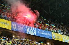 UEFA EURO 2020 Qualifying round: Ukraine - Serbia. LVIV, UKRAINE - JUNE 7, 2019: Ukrainian supporters burn flares during the UEFA EURO 2020 Qualifying game stock image