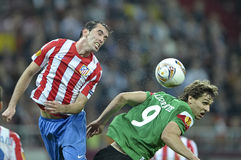 UEFA Europa League Final Bucharest 2012. Fernando Llorente, Atletic Club Bilbao player,fighting for the ball with a Atletico Madrid player during the UEFA Europa Royalty Free Stock Images