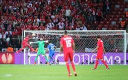 UEFA Europa League Final football game Dnipro vs Sevilla. WARSAW, POLAND - MAY 27, 2015: Carlos Bacca of FC Sevilla (L) attacks goalkeeper Denys Boyko of FC stock images
