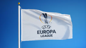 UEFA Europa League flag in slow motion seamlessly looped with alpha. UEFA Europa League flag waving in slow motion against clean blue sky, seamlessly looped stock video