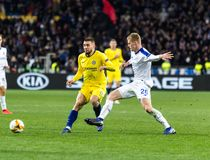 UEFA Europa League football match Dynamo Kyiv – Chelsea, March 14, 2019. Kyiv, Ukraine - March 14, 2019: Mateo Kovacic of Chelsea fighting for the ball royalty free stock photo