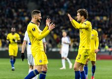 UEFA Europa League football match Dynamo Kyiv – Chelsea, March 14, 2019. Kyiv, Ukraine - March 14, 2019: Olivier Giroud and Marcos Alonso of Chelsea royalty free stock images