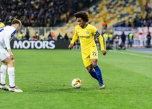 UEFA Europa League football match Dynamo Kyiv – Chelsea, March 14, 2019. Kyiv, Ukraine - March 14, 2019: Willian of Chelsea in action during UEFA Europa royalty free stock photography