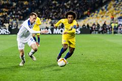 UEFA Europa League football match Dynamo Kyiv – Chelsea, March 14, 2019. Kyiv, Ukraine - March 14, 2019: Willian of Chelsea in action during UEFA Europa stock photography