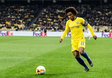 UEFA Europa League football match Dynamo Kyiv – Chelsea, March 14, 2019. Kyiv, Ukraine - March 14, 2019: Willian of Chelsea in action during UEFA Europa royalty free stock image