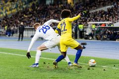 UEFA Europa League football match Dynamo Kyiv – Chelsea, March 14, 2019. Kyiv, Ukraine - March 14, 2019: Willian of Chelsea fighting for the ball with stock image