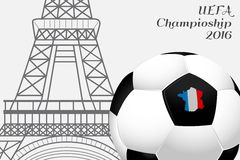 The 2016 UEFA European Championship.  France. Ball with country's borders flag colors and the Eiffel Tower.  Royalty Free Stock Photo