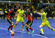 UEFA Futsal Euro 2018 qualifying tournament in Kyiv. KYIV, UKRAINE - APRIL 8, 2017: Players of Ukraine in Yellow and Belgium Black-Red teams in action during Stock Photos