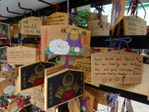 Wooden boards prayers Ema`s hanging in the Toshogu Shrine in Ueno Park, Tokyo stock photos