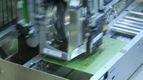 Ufa/Russia - 16.05.2019: Electronic circuit board production. Automated Circut Board machine Produces Printed digital. Electronic board. Manufacture of stock video footage