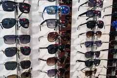 Stand with sunglasses in the store stock photography