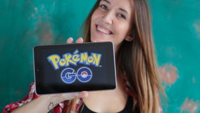 Ufa, Russia. - July 29: Woman show the tablet with Pokemon Go logo, July 29, 2016 in Ufa, Russia stock video footage