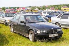 BMW E36 3-series. Ufa, Russia - June 12, 2014: Black motor car BMW E36 3-series at the countryside Stock Photo