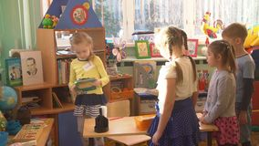 UFA, RUSSIA - MARCH, 2015: children plays active games in nursery. Russian kindergarten is a preschool educational. Institution stock video