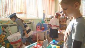 UFA, RUSSIA - MARCH, 2015: children plays active games in nursery. Russian kindergarten is a preschool educational stock footage