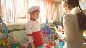 UFA, RUSSIA - MARCH, 2015: children plays active games in nursery. Russian kindergarten is a preschool educational stock video
