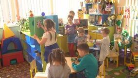 UFA, RUSSIA - MARCH, 2015: children plays active games in nursery. Russian kindergarten is a preschool educational stock video footage