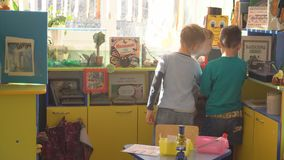 UFA, RUSSIA - MARCH, 2015: children plays active games in nursery. Russian kindergarten is a preschool educational. Institution stock video footage