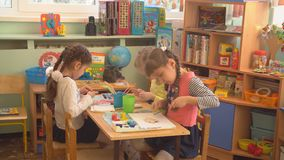 UFA, RUSSIA - MARCH, 2015: children plays creative games in nursery. Russian kindergarten is a preschool educational. Institution stock video footage