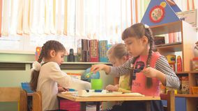 UFA, RUSSIA - MARCH, 2015: children plays creative games in nursery. Russian kindergarten is a preschool educational. Institution stock video