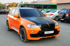 BMW X5. Ufa, Russia - September 23, 2008: Black and orange SUV BMW E70 X5 in the city street royalty free stock photography