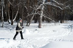 Old Woman Cross Country Skiing in Winter Forest Snow royalty free stock images