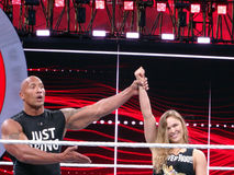 UFC star and Bantamweight Champion Ronda Rousey and the Rock cel. SANTA CLARA - MARCH 29: UFC star and Bantamweight Champion Ronda Rousey and the Rock celebrate Royalty Free Stock Images
