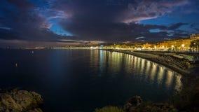 Ufergegend der Nizza Stadt und des Mittelmeertages zum Nacht-timelapse stock footage
