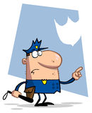 Ufficiale di polizia che indica e che tiene un randello Fotografia Stock Libera da Diritti