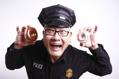 Ufficiale di polizia con le guarnizioni di gomma piuma Fotografie Stock