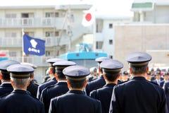 Ufficiali di polizia del giapponese di attenzione Immagini Stock
