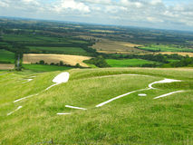 Uffington White Horse. A side view of the Uffington chalk white horse in Oxfordshire, England, on the ancient Ridgeway Path Stock Photography
